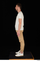 Trent brown trousers casual dressed standing white sneakers white t shirt whole body 0011.jpg